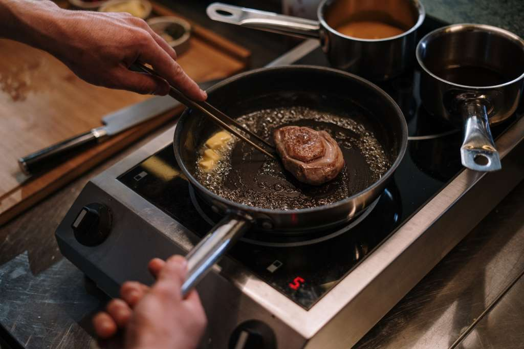 person cooking on black frying pan 4253299